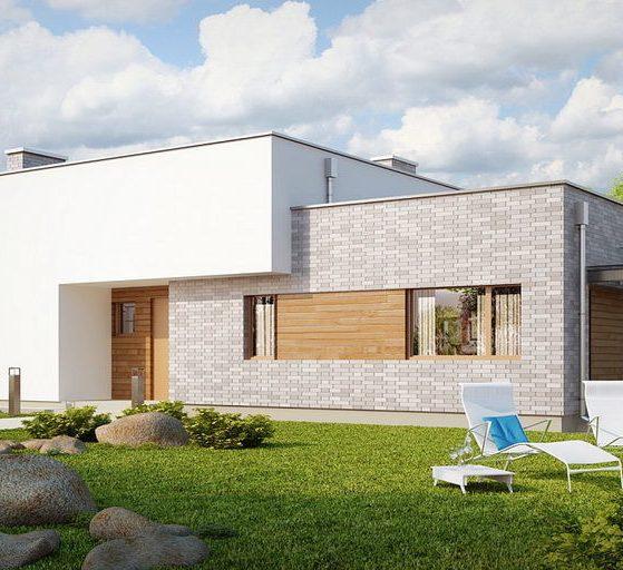 отделка фасада дома панелями под камень