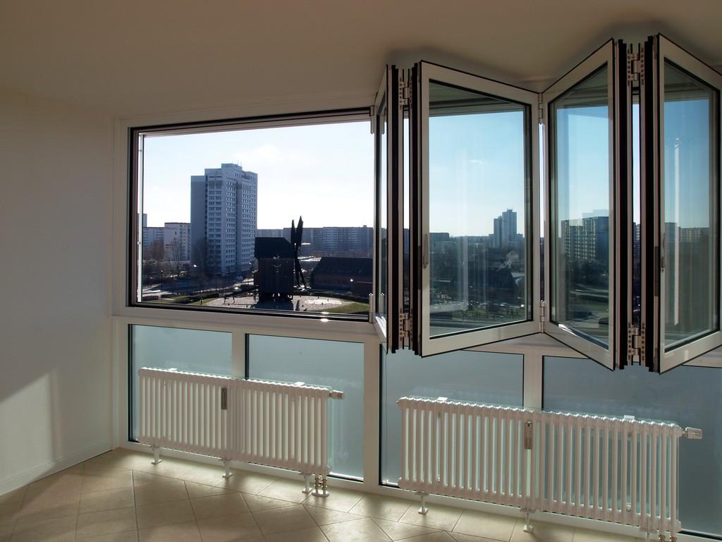 Утепленный панорамный балкон